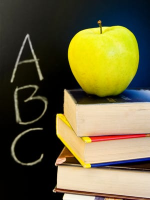 The board voted unanimously Monday in favor of a plan to include students' scores on Advanced Placement, SAT and other tests in addition to scores on a new state assessment when calculating state-issued letter grades.