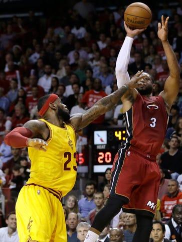 Heat guard Dwyane Wade (3) shoots over Cavaliers forward