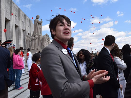 Jesse Elliott, Student Government Association president at Louisiana State University of Alexandria, watches balloons released at the Bring H.E.A.T. rally Wednesday at the State Capitol in Baton Rouge. As chair of the Louisiana Council of Student Body Presidents, Elliott was one of the moderators of the rally organized to bring awareness to severe budgets cuts threatening higher education.