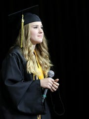 "Hannah Pruett takes the stage to sing ""The Climb"" by Miley Cyrus during Cascade High School's 66th Annual Commencement on Wednesday, June 1, 2016, at the Salem Armory."