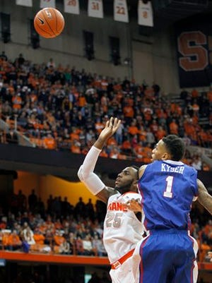 Syracuse's Rakeem Christmas, left, shoots the game winning shot under pressure from Louisiana Tech's Michale Kyser, right, in the final second of an NCAA college basketball game in Syracuse, N.Y., Sunday, Dec. 14, 2014. Syracuse won 71-69. (AP Photo/Nick Lisi)