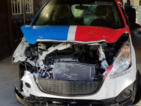 The wrecked Domino's Pizza delivery car bought by Samcrac and rebuilt.