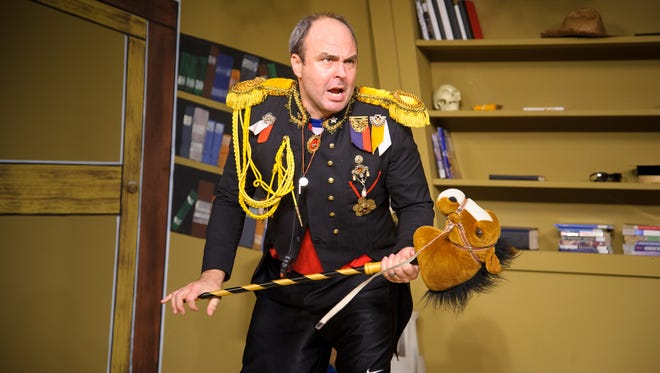 "Doug Jarecki leads the charge during In Tandem Theatre's production of ""All the Great Books (Abridged)."""