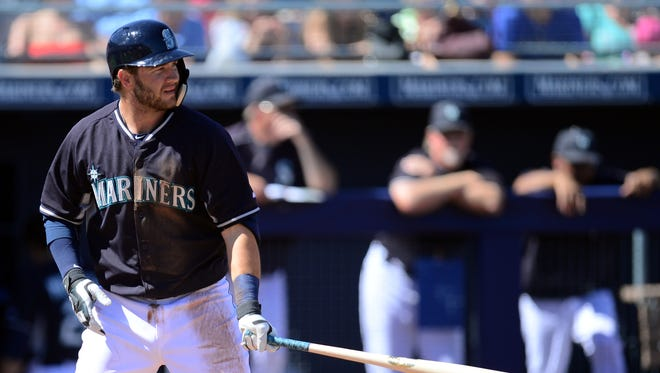 Seattle Mariners third baseman D.J. Peterson (46) bats against the Los Angeles Dodgers at Peoria Sports Complex.