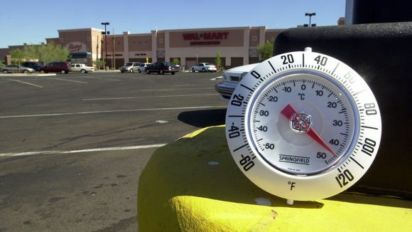 DIGITAL -- 25921 -- In direct sun the temperature soars close to 120 degrees near the asphalt of the Wal-Mart Supercenter in north Scottsdale making it one of the warmer areas of the east valley.  Photo by Tim Koors  6/14/00