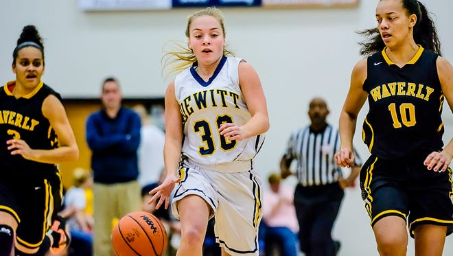 DeWitt's Mackenzie Dawes ,30,  drives to the Waverly basket while being pursued by Waverly's Isabella Pizzo ,10, during the meeting between the teams last month.
