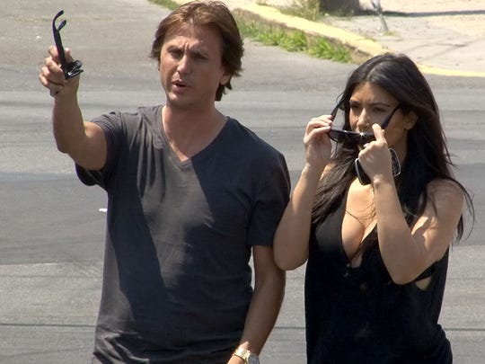 Kim Kardashian and her friend Jonathan Cheban arrive at the Seaside Heights boardwalk on July 8.