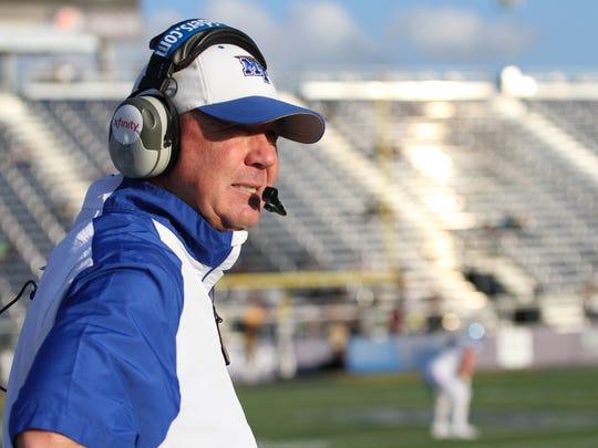 MTSU's head coach, Rick Stockstill, looks down the