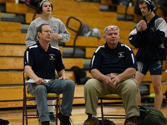 Farmington wrestling coaches Howard Welsh (left) and Al Beyar keep a close watch on one of their wrestlers in Wednesday's quad meet.