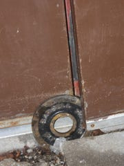 A weight is used to prop open a door at Iowa Valley