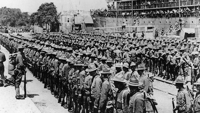 The first regiments of the American Expeditionary Force during World War I land in France on June 26, 1917. Here, Yanks from the first convoy line up after debarking at Saint-Nazaire.
