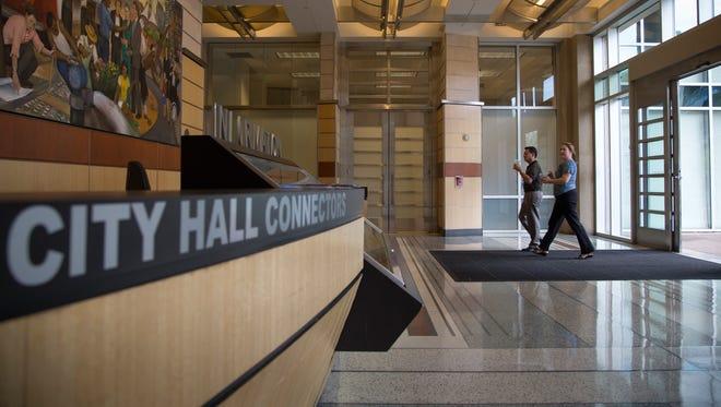 Visitors enter Phoenix City Hall through the southwest doors, Sept. 12, 2016, in Phoenix.