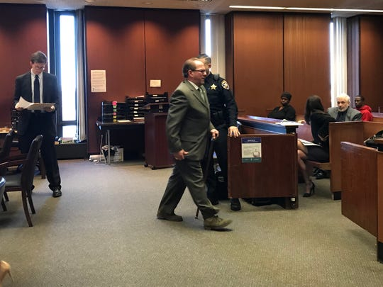 Nutley resident and retired Newark Police Officer Dino D'Elia exits the courtroom on Friday, Dec. 1, 2017 following his sentencing for misuse of consumer information accessed through a law enforcement database.