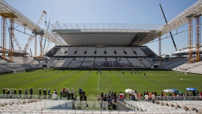 Brazilian club Corinthians soccer players practice at the Itaquerao, the stadium that will host the World Cup opener in Sao Paulo, Brazil.