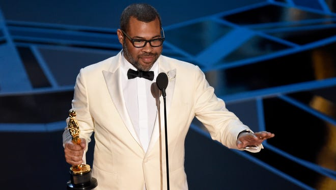"Jordan Peele accepts the award for best original screenplay for ""Get Out"" at the Oscars on March 4."