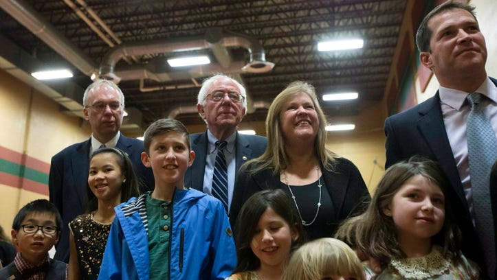 Bernie Sanders watches primary results with his family on Feb. 9, 2016, in Concord, N.H.