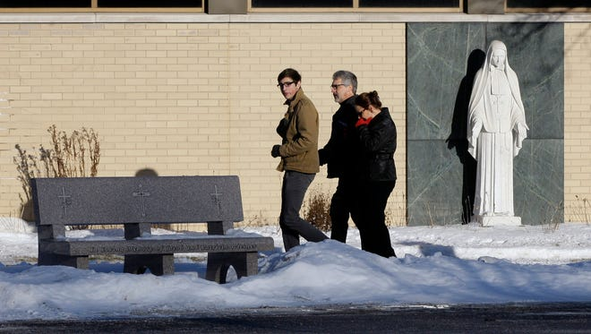 Mourners arrive at St. Frances Cabrini Church in West Bend, Wis., on Tuesday before funeral services for Andrew Boldt, who was fatally shot and stabbed last week by another student at Purdue University.