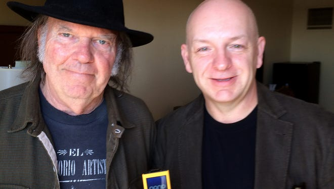 Neil Young, left, and USA TODAY reporter Mike Snider with a PonoPlayer high-resolution portable music device at the South By Southwest festival on March 11 in Austin.