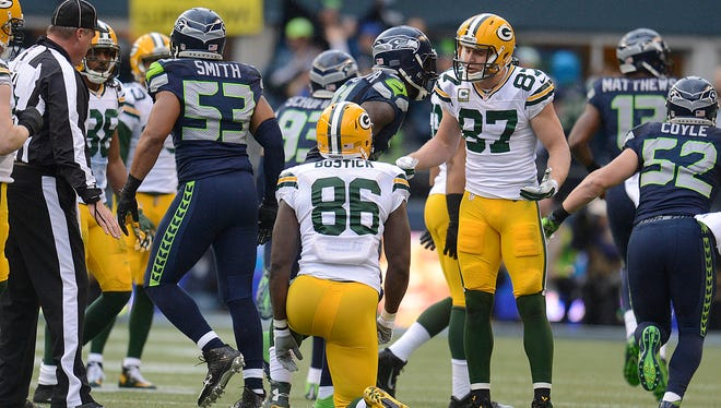 Green Bay Packers' Jordy Nelson (87) yells at teammate Brandon Bostick (86) after Bostick dropped an onside kick against the Seattle Seahawks during Sunday's NFC Championship game at CenturyLink Field in Seattle, Wash. The Seahawks recovered the ball on the play.