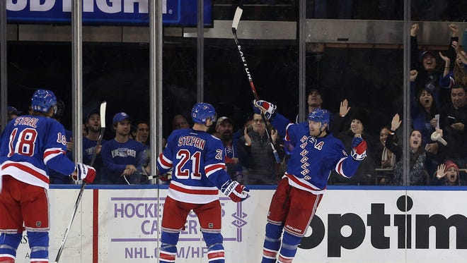 Nov 3, 2016; New York, NY, USA; New York Rangers left wing Rick Nash (61) celebrates his goal against the Edmonton Oilers with New York Rangers center Derek Stepan (21) and New York Rangers defenseman Marc Staal (18) during the third period at Madison Square Garden. Mandatory Credit: Brad Penner-USA TODAY Sports