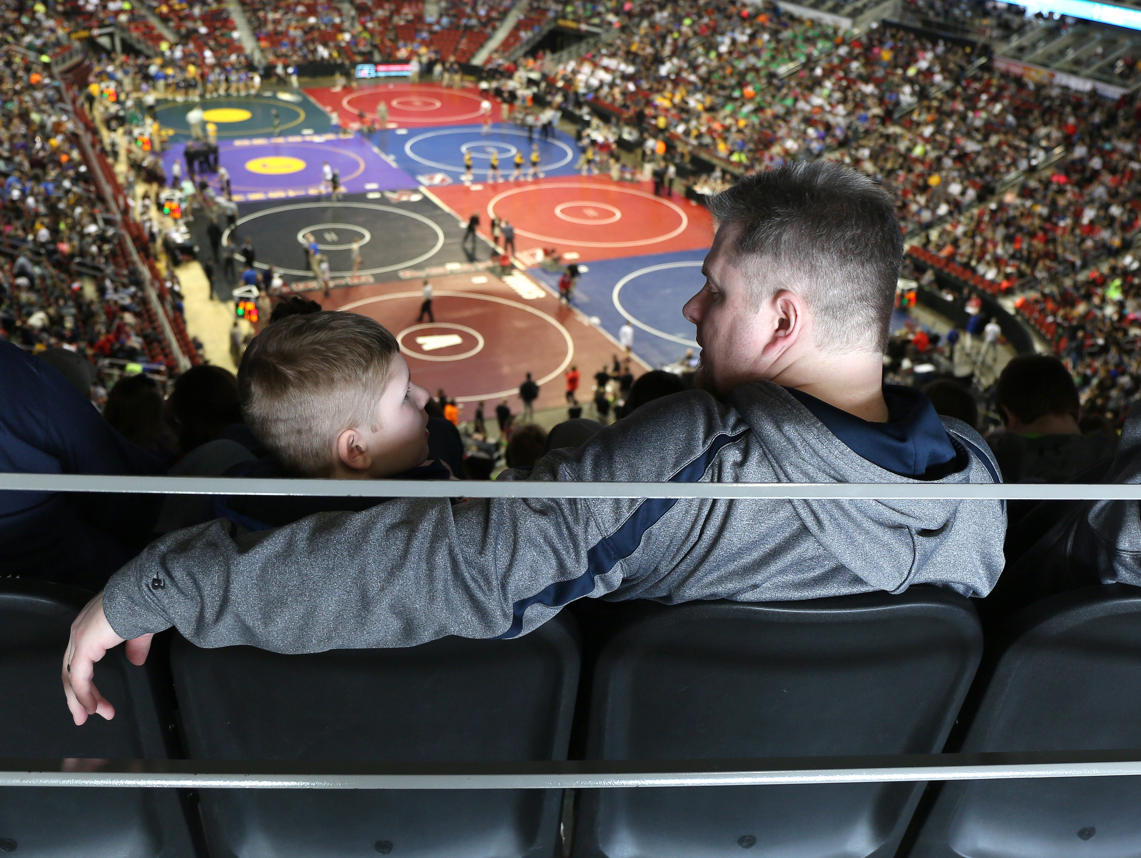 Wrestling fans take in the action from the afternoon session in Class 1A and 3A on Friday, Feb. 20, 2015, during the 2015 Iowa state wrestling meet at Wells Fargo Arena in Des Moines, Iowa.