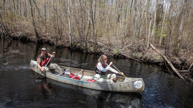 John and Leann Volpa of Evesham paddle on the Mullica River after leaving the new Pinelands Adventures Center the Pinelands Preservation Alliance is opening to the public