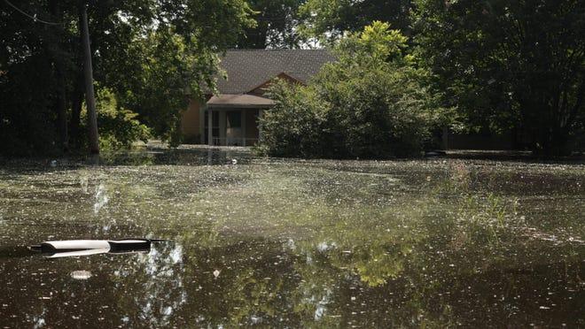 A home at Garden Street in Shreveport's Allendale neighborhood is under water Sunday.