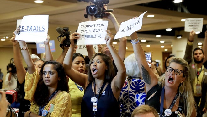 Protesters yell as DNC Chairwoman, Debbie Wasserman Schultz, D-Fla., arrives for a Florida delegation breakfast, Monday, July 25, 2016, in Philadelphia, during the first day of the Democratic National Convention. (AP Photo/Matt Slocum)