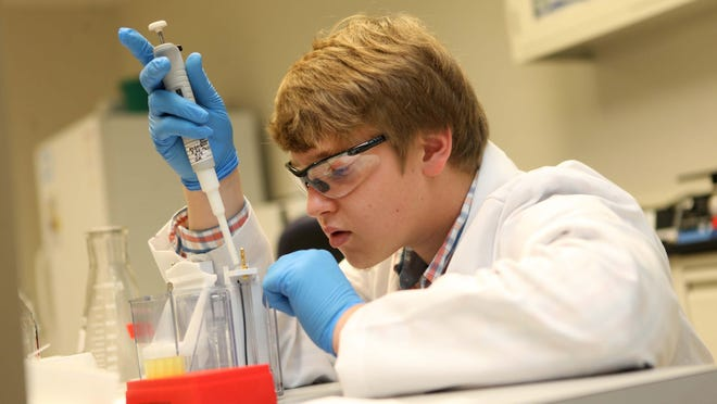 Research technician John Rosenberger prepares a test at CD Diagnostics in Claymont. The company was acquired on Monday.