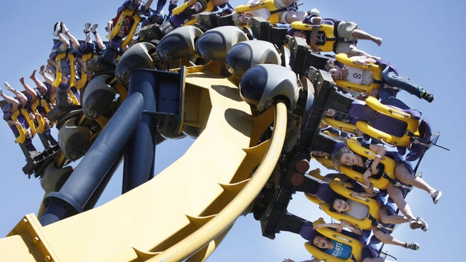 People ride the Batman Returns roller coaster at Six Flags Over Texas in Arlington, Texas on April 24, 2010.