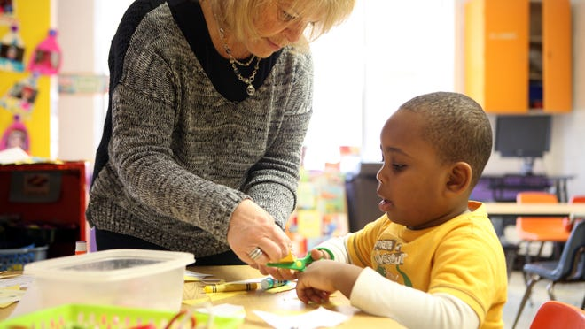 Teacher assistant Felice Burgay works with Lawrence Petit on Wednesday in prekindergarten at Temple Beth El in Spring Valley. It is one of several sites East Ramapo uses for prekindergarten.