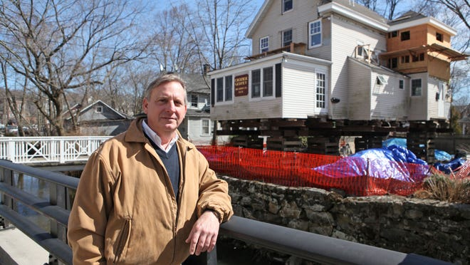 Architect Rex Gedney, who is raising his office to escape flooding and has worked on raising many homes in the area, is photographed April 1, 2014 in Rye. The Blind Brook runs next to his office.