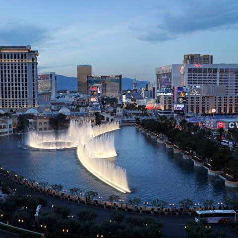 The fountains of Bellagio erupt along the Las...