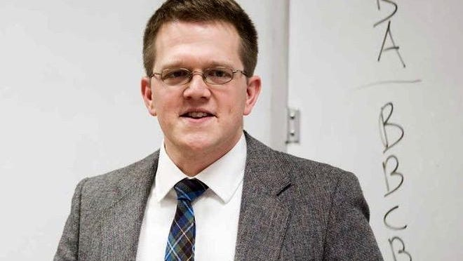 Benedict Whalen, associate professor of English, was named Professor of the Year by Hillsdale College's 2020 graduating class.