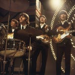 The Beatles perform in June 1966 at TV studios in London.  From left to right:  John Lennon, Ringo Starr, Paul McCartney and George Harrison.