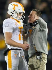Tennessee Head Coach Butch Jones speaks with Tennessee quarterback Will McBride (17) during a game between Tennessee and Missouri at Faurot Field in Columbia, Missouri, on Saturday November 11, 2017.