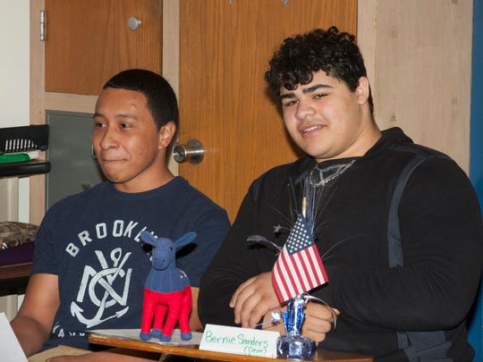 Justin Dixon and Youssef Mohamed, who played Bernie Sanders, react to a question from the audience during the mock press conference.