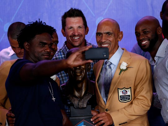 Former Indianapolis Colts running back Edgerrin James, tight end Dallas Clark and wide receiver Reggie Wayne take a selfie with Hall of Fame inductees Marvin Harrison and Tony Dungy during the NFL Hall of Fame Enshrinement Ceremony at Tom Benson Hall of Fame Stadium in Canton, Ohio, on Aug. 6, 2016.
