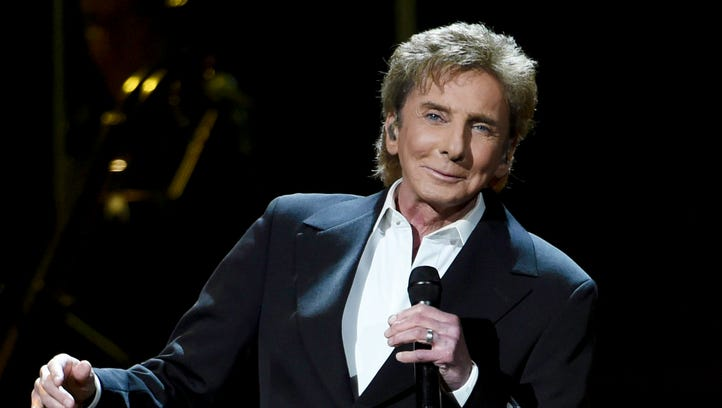 Singer and songwriter Barry Manilow performs at the