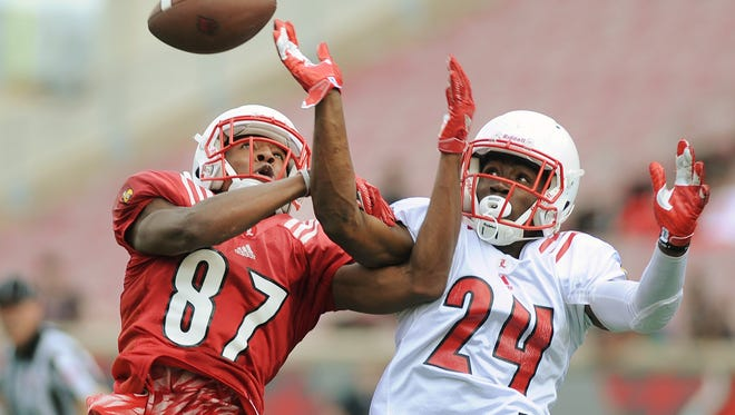 Louisville's Zykiesis Cannon (24) breaks up a catch attempt by Dez Fitzpatrick (87) during the UofL Spring Game on Saturday at Papa John's Cardinal Stadium. April 15, 2017