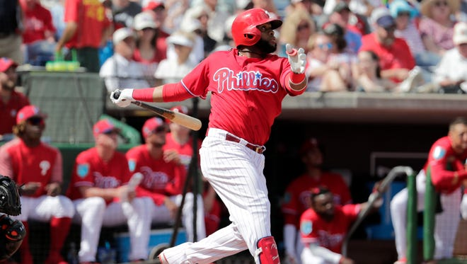 Phillies first baseman Carlos Santana bats during a recent spring training game. He has a career on-base percentage of .365.
