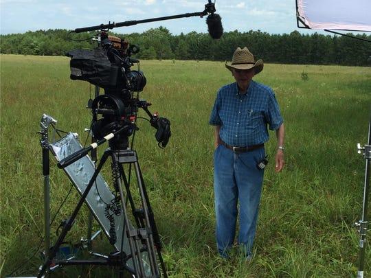 A landowner is being interviewed on-site.