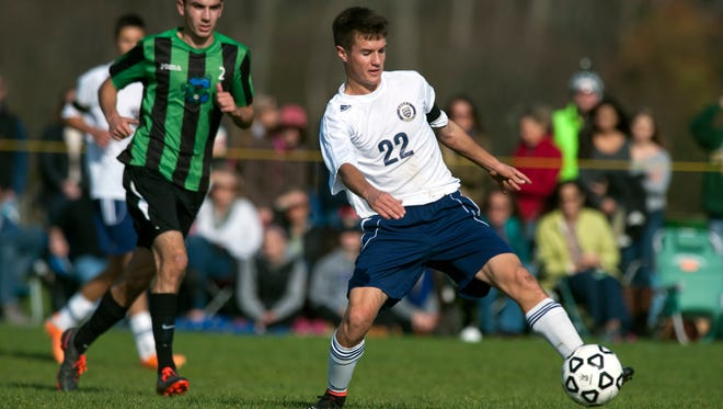 Essex's Nate Miles (22) plays the ball during the Saturday's boys soccer playoff game against Colchester.