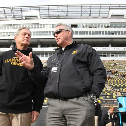 Iowa  coach Kirk Ferentz of the Iowa Hawkeyes visits