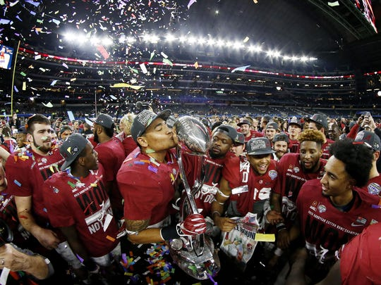 The Alabama Crimson Tide celebrate with the trophy after defeating the Michigan State Spartans 38-0 in the Goodyear Cotton Bowl at AT&T Stadium on December 31, 2015 in Arlington, Texas. (Photo by Ron Jenkins/Getty Images)