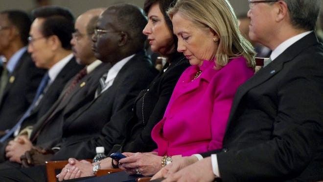 Secretary of State Hillary Rodham Clinton checked her Blackberry phone alongside South Korean Foreign Minister Kim Sung-hwan as she attended the Fourth High Level Forum on Aid Effectiveness in Busan, South Korea Wednesday, Nov. 30, 2011.