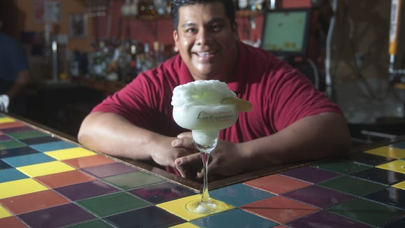 Oscar Miguel combines 100 percent agave tequila, triple sec and Daily?s mix in La Esperanza?s frozen house margarita.  Jose F. Moreno/Courier-Post Oscar Miguel shows a frozen house margarita at La Esperanza Restaurant & Bar in Lindenwold. 07.03.12