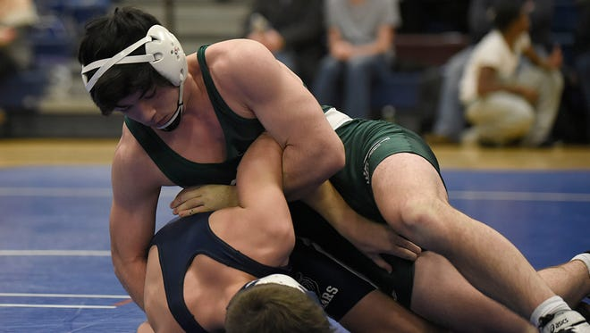 Groves senior Colin Takata is undefeated this season following Wednesday's victory over  Berkley's Scott Smith in the 145-pound weight class.