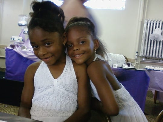 Tesia Thomas, left, and sister Trinity Thomas pose