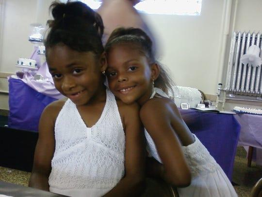 Tesia Thomas, left, and sister Trinity Thomas pose for a snapshot in this 2008 photo.